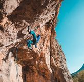 A man climbs the rock. Climbing in nature. Fitness outdoors. Active lifestyle. Extreme sports. The athlete trains on a natural relief. Rock climbing in Turkey Royalty Free Stock Image