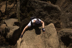 Man climbs on a rock stock images
