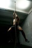 Man climbs ropa at gym Stock Photos