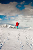 Man climbs on a snow slope Stock Image