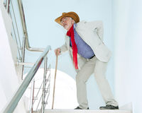 Man climbs the stairs with the pain in his back Stock Images
