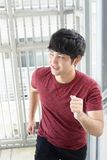 Man climbs the stairs. Smiling Asian man climbs the stairs Stock Image