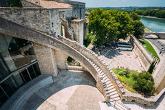Man climbs the stairs to the walls of the fortress stock image