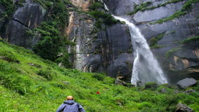A man climbs up to the Jogini waterfall in Vashisht, Himachal & Pradesh stock video