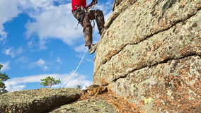 Man Climbs Up on top of the Rock Royalty Free Stock Photography