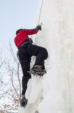 Man climbs upward on ice climbing competition Royalty Free Stock Photography