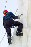 Man climbs upward on ice climbing competition Royalty Free Stock Images