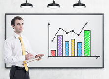 Man with clipboard and colorful graph Royalty Free Stock Photo