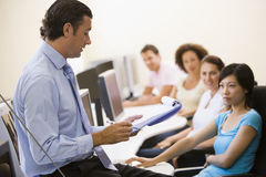 Man with clipboard giving lecture Royalty Free Stock Photo