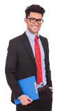 Man with clipboard & hand in pocket Stock Photo
