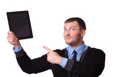 Man with a clipboard in his hand and raised finger up, isolated on white Royalty Free Stock Photos