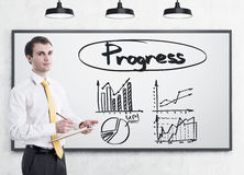 Man with clipboard and progres graphs Stock Images