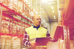 Man with clipboard in safety vest at warehouse Royalty Free Stock Photo