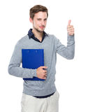Man with clipboard and thumb up. Isolated on white background stock images