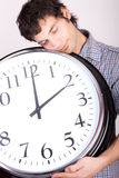 Man with clock Stock Images