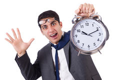 Man with clock afraid to miss deadline isolated Royalty Free Stock Photography