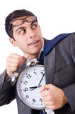 Man with clock afraid to miss deadline Royalty Free Stock Images