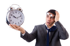 Man with clock afraid to miss deadline Royalty Free Stock Photo