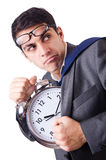 Man with clock afraid to miss deadline isolated Royalty Free Stock Images