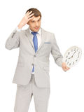 Man with clock Royalty Free Stock Images