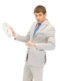 Man with clock Stock Photos