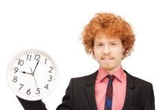Man with clock Royalty Free Stock Photos