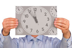 Man with Clock Face. Man with clock covering his face. It is almost midnight or noon Stock Photography