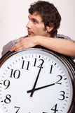 Man and clock Stock Photos