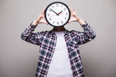 Man with clock over head. Handsome man with clock over head Royalty Free Stock Photos