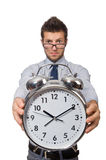 Man with clock trying to meet the deadline isolated Stock Photo
