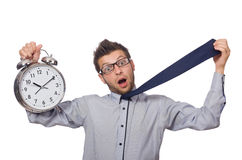 Man with clock trying to meet the deadline isolated Stock Photos