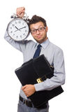 Man with clock trying to meet the deadline Royalty Free Stock Photography