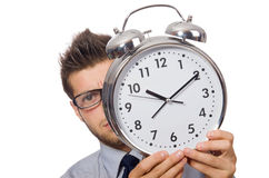 Man with clock trying to meet the deadline Stock Image