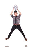 Man with clock trying to meet the deadline isolated Royalty Free Stock Photo