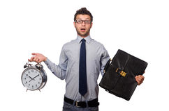 Man with clock trying to meet the deadline isolated Royalty Free Stock Images