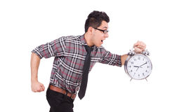 Man with clock trying to meet the deadline isolated Royalty Free Stock Photography
