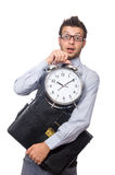 Man with clock trying to meet the deadline isolated Stock Photography
