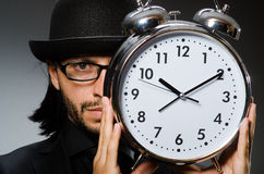 Man with clock wearing. Vintage hat royalty free stock images