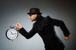 Man with clock wearing Stock Photography