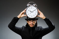Man with clock wearing Stock Images