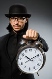 Man with clock wearing Royalty Free Stock Photo