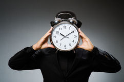 Man with clock wearing Royalty Free Stock Image