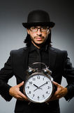 Man with clock wearing Royalty Free Stock Photos