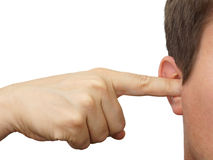 Man clog his ears with fingers Stock Image