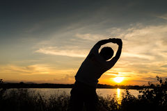 Man close arms under the sunrise Royalty Free Stock Photos