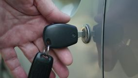 Man Close and Lock the Vehicle Door Using Mechanical System and Car Key.  stock video footage