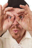 Man close look through hands wide eyes Royalty Free Stock Image