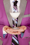 Man close purple suit drink on hands Stock Photos