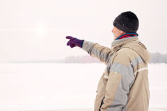 Man Close to the Frozen River in Magic Winter Royalty Free Stock Image