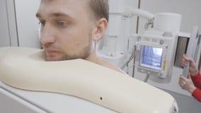 Man close up at roentgen diagnostic x-ray examining procedure